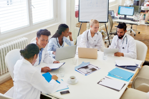 Group of doctors in medical school discussing and learning as team